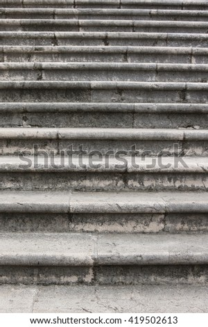Detail of the steps of an old stone stairway - stock photo
