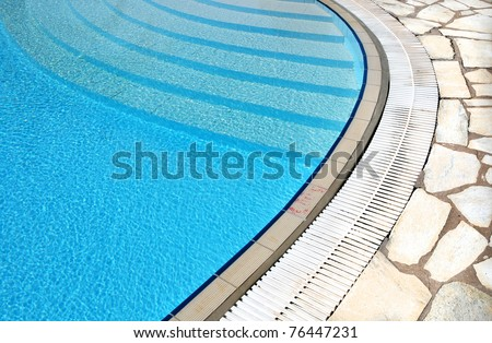 Detail of the swimming pool with clean water - stock photo