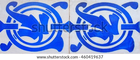 Detail of the traditional tiles from facade of old house - stock photo