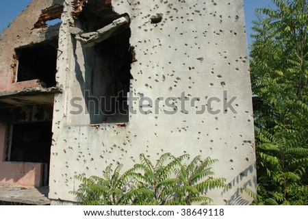 detail of the wall of a private house near Mostar in Bosnia, where serbs attacked a family and murdered the occupants - stock photo