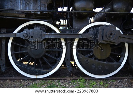 Detail of the wheels of an old steam train  - stock photo
