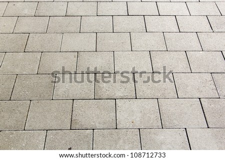 detail of tiles at the street gives a harmonic pattern - stock photo