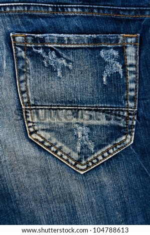 Detail of torn Blue denim, front view  jean  background or texture - stock photo
