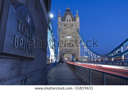 Detail of Tower Bridge in London at dusk with car light trail. - stock photo