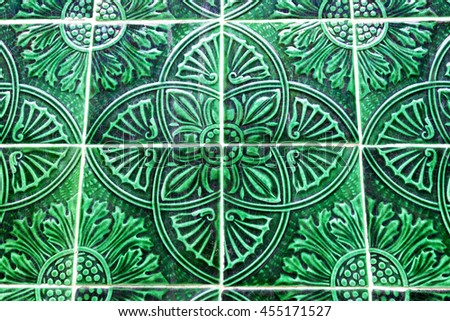 Detail of traditional azulejos tiles on facade of old house, Porto, Portugal - stock photo