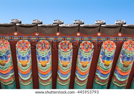 Detail of Traditional Korean Roof, Colourful Decorated Ornament for Ancient Korean Palace or Temple at Seoul, South Korea. - stock photo
