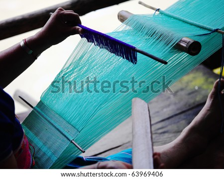 detail of traditional thai loom at work - stock photo
