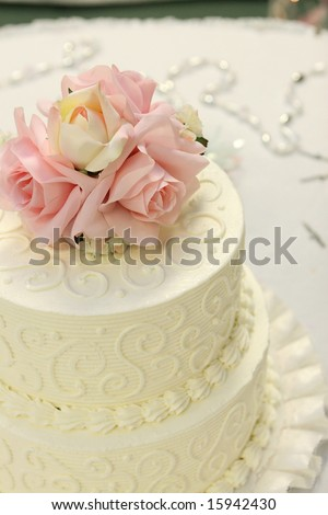 Detail of traditional wedding cake with pink and cream roses. - stock photo