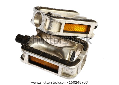 Detail of two used bicycle pedals isolated on white - stock photo