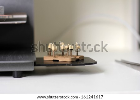detail of unfinished ceramic crowns - stock photo