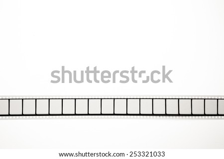 Detail of unrolled 35mm movie reel with empty frames in horizontal position, vintage black and white on white background - stock photo