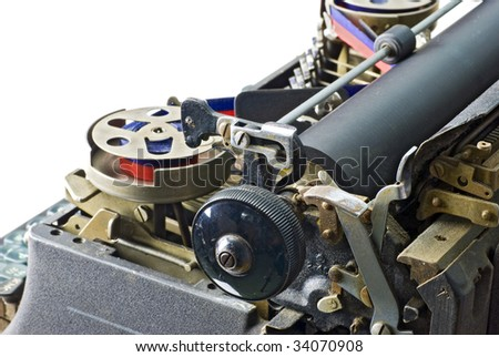 detail of vintage, mechanical typewriter showing carriage, ribbon spool etc; isolated against white ground - stock photo