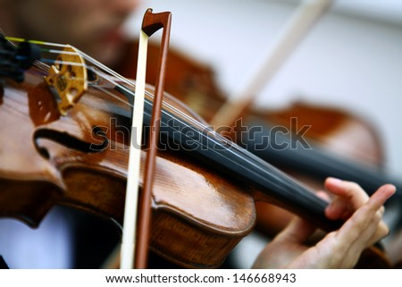 Detail of viola being played by a musician - stock photo