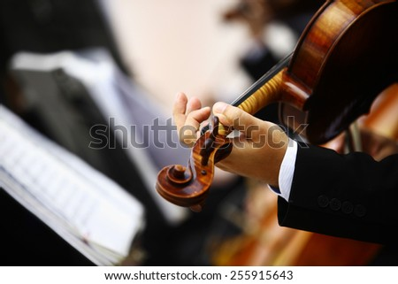 Detail of violin being played by a musician - stock photo