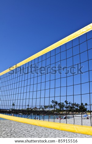 Detail of volley net wit a perfect blue sky on beach - stock photo