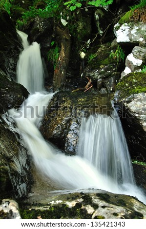 Detail of waterfall in wild scottish nature - stock photo