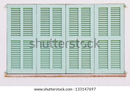 Detail of weathered green shutters of a spanish house - stock photo