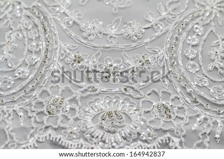Detail of wedding dress (macro) - stock photo