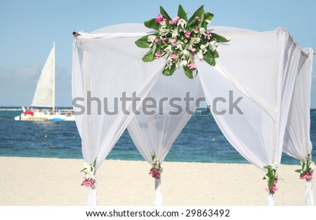 Detail of wedding gazebo on a tropical sand beach - stock photo