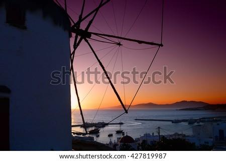 Detail of windmill on Mykonos island, Greece at beautiful sunset - stock photo