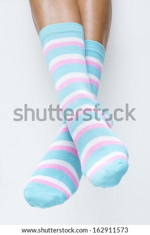 Detail of woman legs in striped socks - stock photo