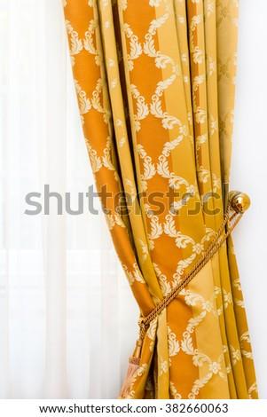 Detail of yellow-golden vintage drapery - stock photo