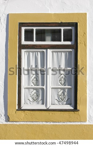 Detail of yellow window on a old house at algarve, south of Portugal - stock photo