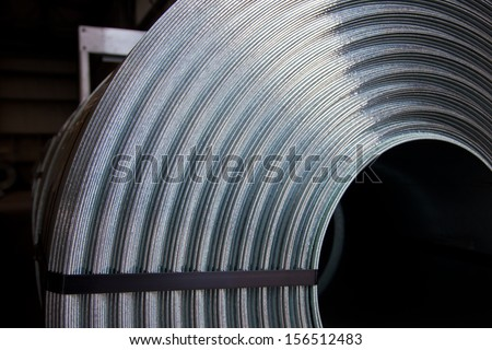 Detail of zinc coated steel plate coil - stock photo