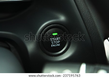 Detail on a black start button in a car - stock photo