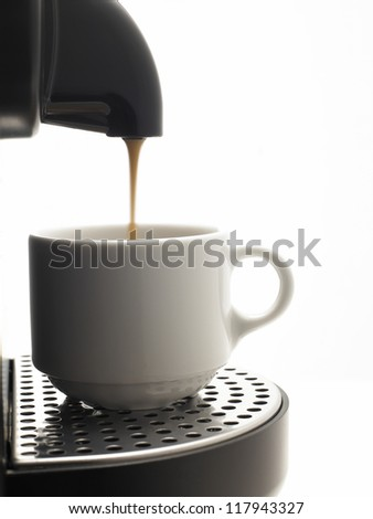 Detail on a white background a coffee machine with cup - stock photo