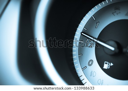 Detail on the fuel level indicator in a car - stock photo