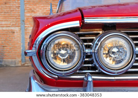 detail on the headlight of a vintage car - stock photo
