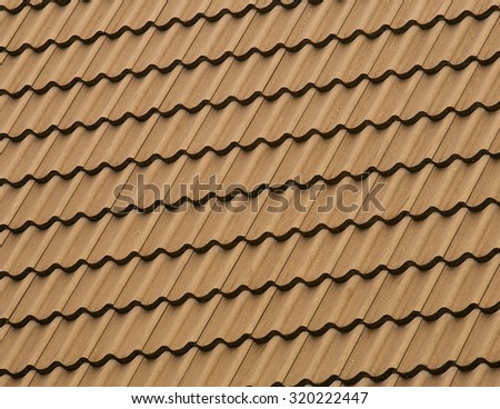 Detail patten of a tiled rooftop covered in clay tiles. - stock photo