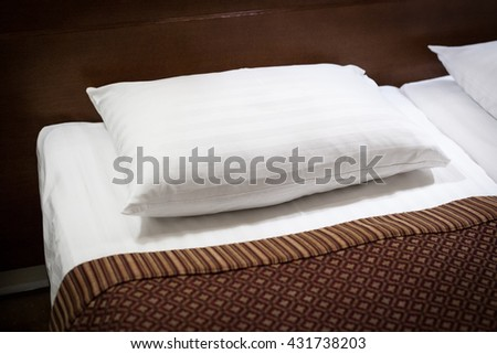 Detail Pillows.Pillow Bed.Pillowcases.Detail Bed.Hotel Room.White Pillow.Cozy Bedroom.Sleeping Hotel Suite.Hotel Suite.Hotel Bedroom.Classic Wooden Bed. - stock photo