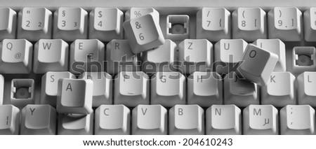 detail shot of a broken computer keyboard - stock photo
