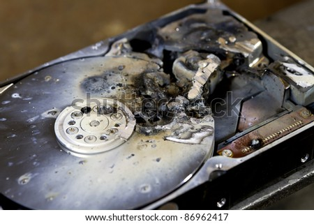 detail shot of a massive destroyed hard disk drive - stock photo