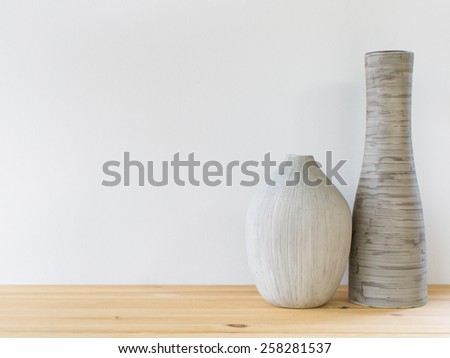 Detail shot of contemporary vases on the wooden shelf. Interior design. - stock photo