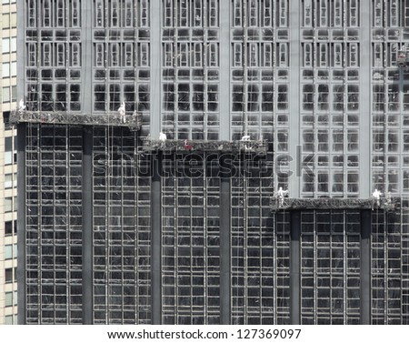 detail shot of some facade workers on a skyscraper facade in New York(USA) - stock photo