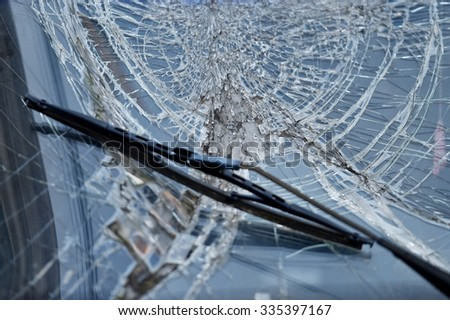 Detail shot with a broken car windshield after accident - stock photo