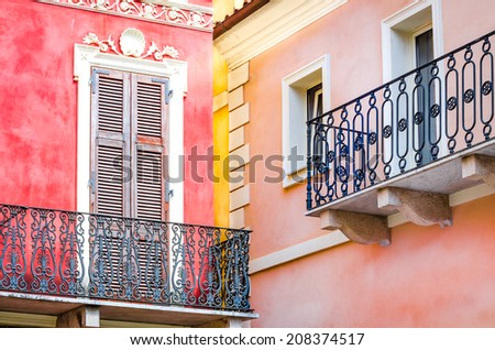 Detail view of colorful walls and balconies with windows and doors - stock photo