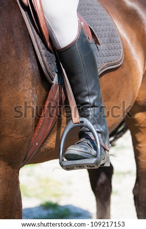 Detail view to horse and horseman - stock photo