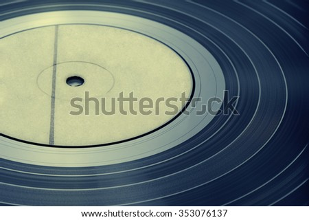 Detail vinyl record, vintage toning, shallow DOF - stock photo