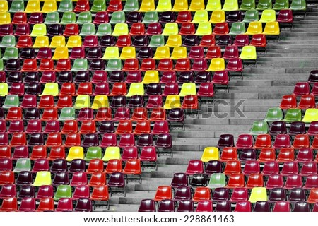 Detail with empty colored sports arena tribune on a football stadium - stock photo