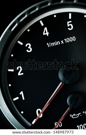 Detail with the tachometer of a sports car - stock photo