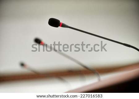 Detail with three press conference microphones - stock photo