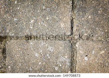 Detailed close up of a section of interlocking bricks forming a cross pattern.   A great texture image for a background or overlay.  Space for copy. - stock photo