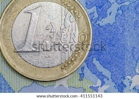 Detailed close up of an one euro coin on a twenty euro banknote - stock photo