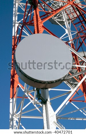 Detailed image of part of a red and white tower of communications with a telecommunication antenna against beautiful blue sky - stock photo