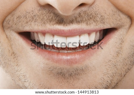 Detailed image of young man smiling with perfect white teeth - stock photo