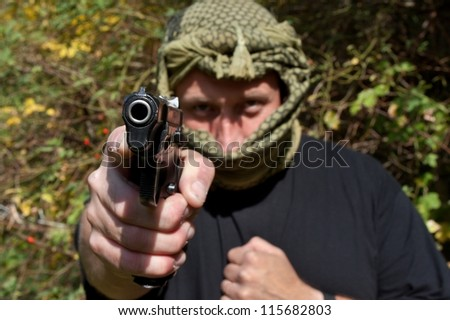 detailed insight into the barrel, pointing terrorists - stock photo